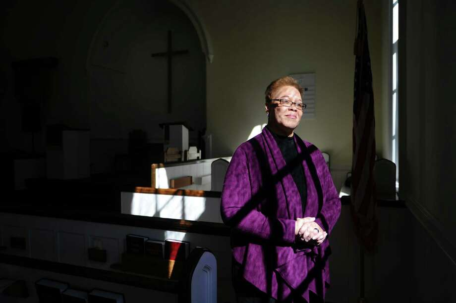 North Stamford Congretional Church Rev. Jacqueline Gilchrist poses for a photo inside her church on Thursday, Feb. 18, 2016. The church, which was founded in 1782, elected Rev. Gilchrist to lead them in October. Photo: Michael Cummo / Hearst Connecticut Media / Stamford Advocate