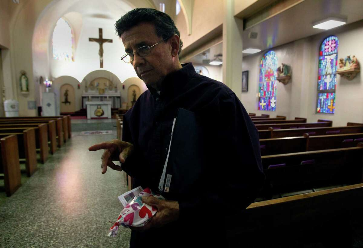 MCALLEN, Texas - Carlos Cantu,77, remembers Irene Garza after a mass at Sacred Heart Catholic Church in McAllen. Texas. Cantu's mother was a seamstress who made several pageant dresses for the beauty queen. Photo by Delcia Lopez