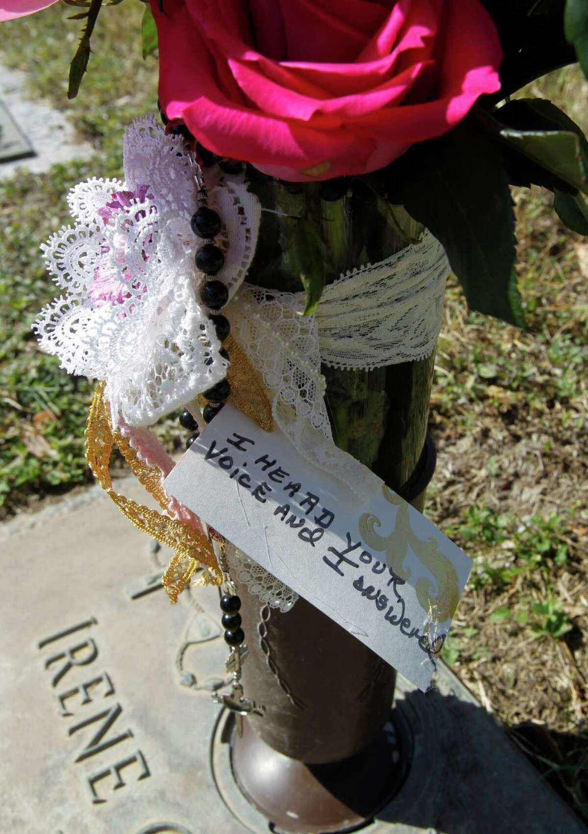 MCALLEN, Texas - The gravesite of Irene Garza with fresh flowers a cross and a hand written note at Valley Memorial Gardens Photo by Delcia Lopez
