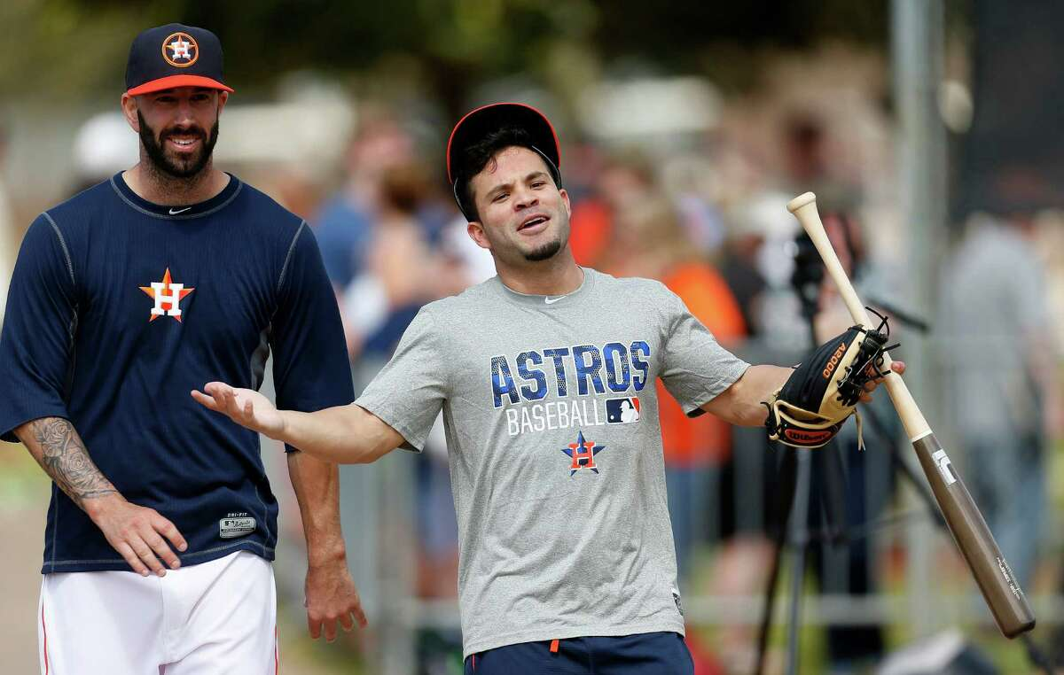 Houston Astros Jose Altuve greets manager A.J. Hinch during spring training in Kissimmee, Florida, Saturday, Feb. 20, 2016.