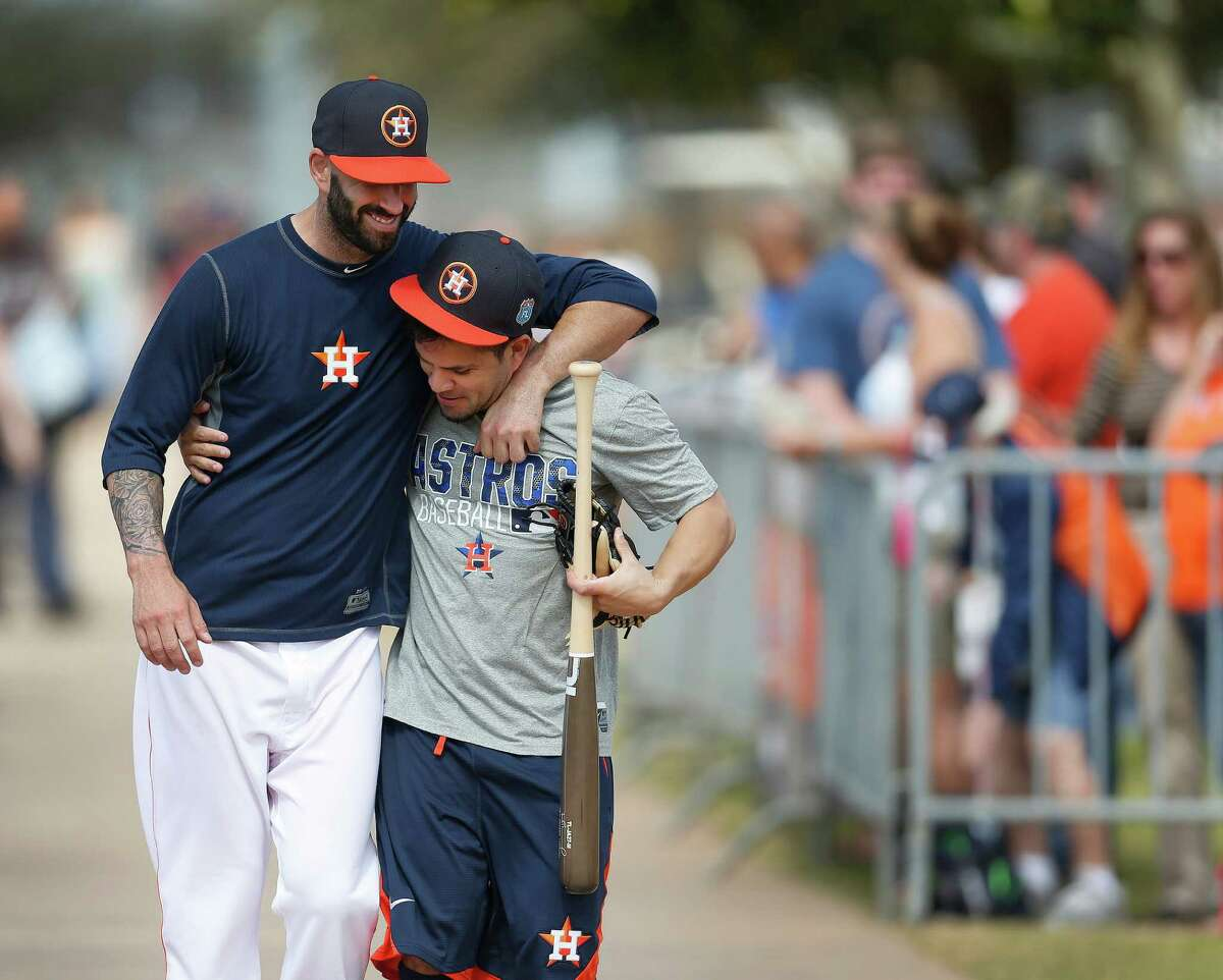 Houston Astros pitcher Mike Fiers hugs Jose Altuve during spring training in Kissimmee, Florida, Saturday, Feb. 20, 2016.