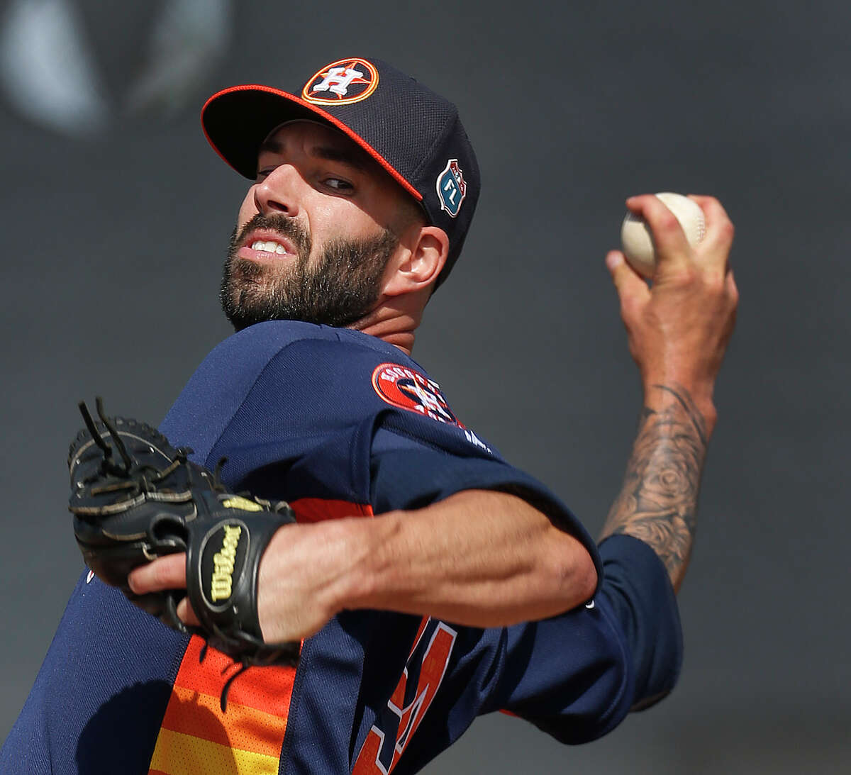 Houston Astros pitcher Mike Fiers pitches off the ten-pack during spring training in Kissimmee, Florida, Saturday, Feb. 20, 2016.