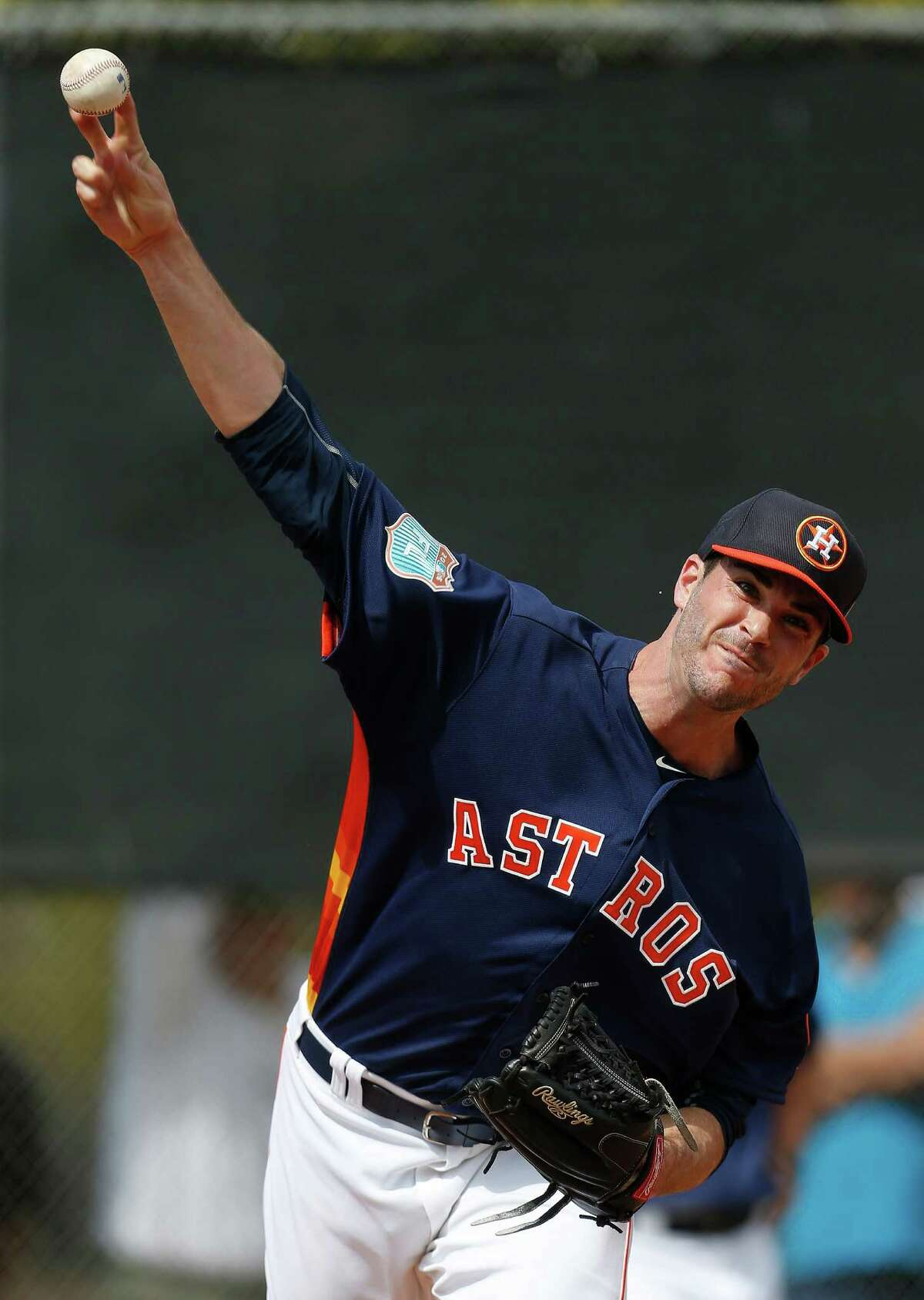 Houston Astros pitcher James Hoyt pitches during the first workout for Houston Astros pitchers and catchers for spring training in Kissimmee, Florida, Friday, Feb. 19, 2016.