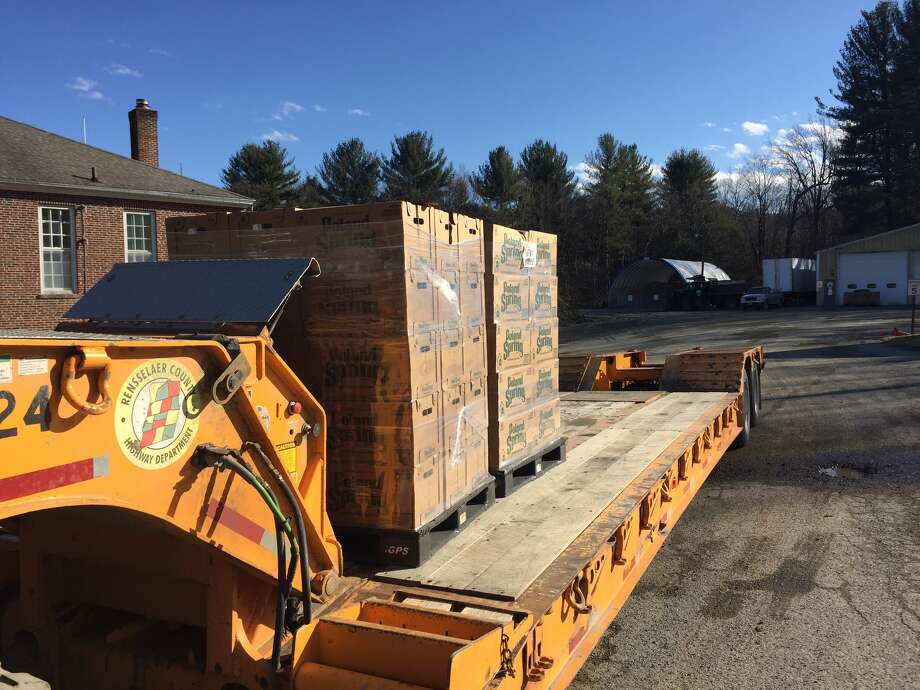 Pallettes of bottled water are brought in for distribution to Petersburgh, N.Y., residents on Saturday, Feb. 20, 2016, after state Health Department tests of well and tap water detect the toxic chemical PFOA. (Kenneth C. Crowe II/Times Union)