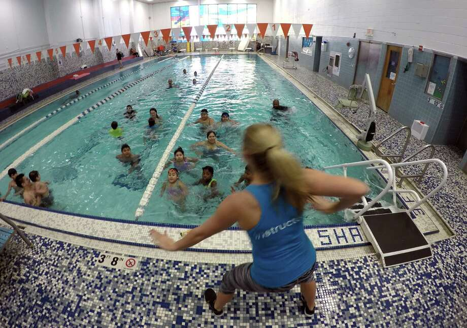 Instructor Amber Allen of Fairfield, Conn. leads a group of participants in an Aqua Zumba class at the Stamford Family YMCA on Feb. 20, 2016. The program was one of several offered during an Open House for community residents. The day featured a variety of fitness class offerings, a cheerleading exhibition, as well as priority registration for youth sports, dance, and swim Spring sessions.  The Stamford Family YMCA is dedicated to providing the community accessible options for healthy living and youth development.