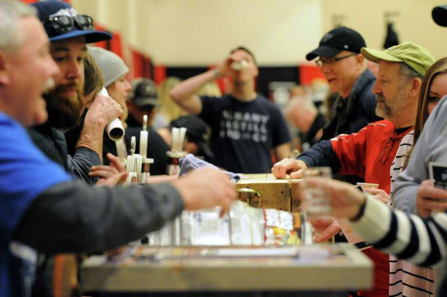 Craft brewers offer their wares during the 5th Annual Beer Summit at the Saratoga City Center on Saturday Feb. 20, 2016 in Saratoga Springs, N.Y. New York .(Michael P. Farrell/Times Union) Photo: Michael P. Farrell / 20035497A