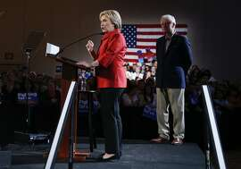 Democratic presidential candidate Hillary Clinton, left, arrives on stage with from her husband and former President Bill Clinton for a Nevada Democratic caucus rally, Saturday, Feb. 20, 2016, in Las Vegas. (AP Photo/John Locher)
