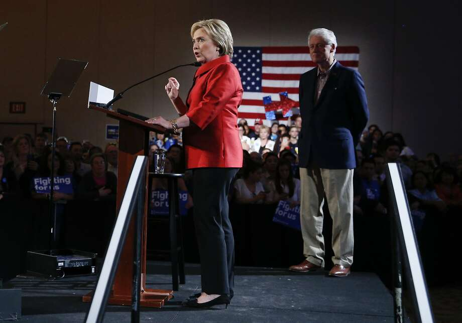 Hillary Clinton arrives for a Nevada Democratic caucus rally in Las Vegas with her husband, former President Bill Clinton. Photo: John Locher, Associated Press