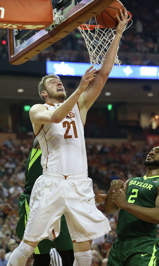 Longhorn forward Connor Lammert moves under the hoop to get a reverse layup in the first half against Rico Gathers as UT hosts Baylor in men's basketball at the Erwin Center on February 20, 2016. Photo: TOM REEL, STAFF / SAN ANTONIO EXPRESS-NEWS / 2016 SAN ANTONIO EXPRESS-NEWS