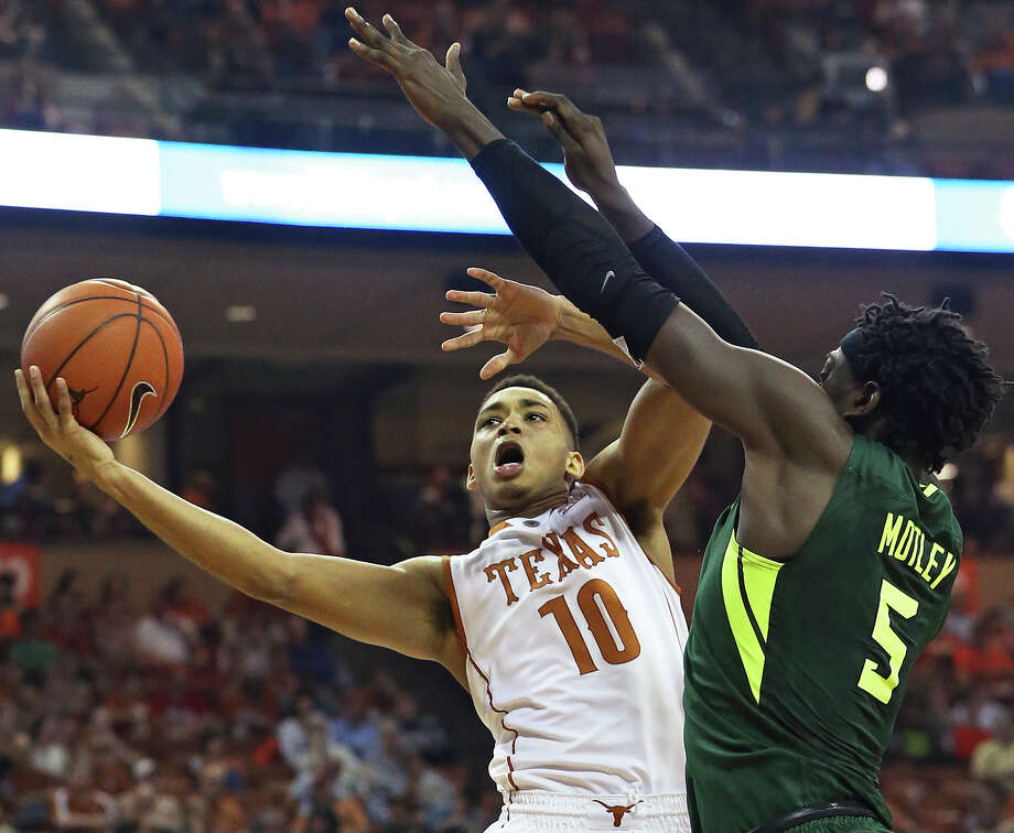 Longhorn guard Eric Davis challenges Bear forward Johnathan Motley at the hoop as UT hosts Baylor in men's basketball at the Erwin Center on February 20, 2016. Photo: TOM REEL, STAFF / SAN ANTONIO EXPRESS-NEWS / 2016 SAN ANTONIO EXPRESS-NEWS