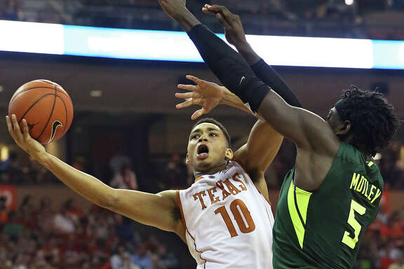 Longhorn guard Eric Davis challenges Bear forward Johnathan Motley at the hoop as UT hosts Baylor in men's basketball at the Erwin Center on February 20, 2016.