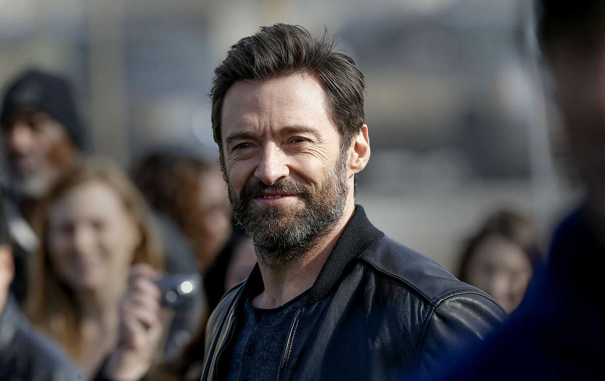 Taron Egerton and Hugh Jackman, (pictured) co-stars of the new movie, Eddie The Eagle, on Sat. February 20, 2016, in Oakland, California. They joined NFL star Marshawn Lynch during his youth football training program at Lynch's former high school Oakland Technical.