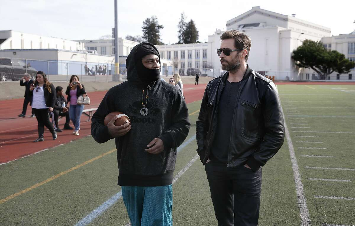 Hugh Jackman joins NFL star Marshawn Lynch, (left) at Oakland Technical.