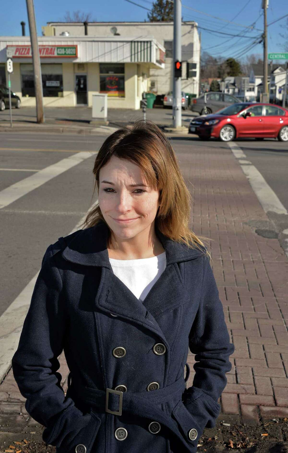 Misty Kinner recounts being struck by a car while crossing Central Avenue at the corner of Central Avenue and Osborne Road during an interview there Tuesday Feb. 2, 2016 in Colonie, NY. (John Carl D'Annibale / Times Union)