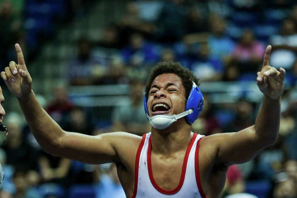 Houston Clear Lake wrestler Camden Fontenote celebrates after beating Keller Central High School wrestler Blaine Martinez 6-5 to win the championship round of the 6A, 132 UIL Wrestling State Championships at the Berry Center Saturday, Feb. 20, 2016. Photo: Michael Ciaglo, Houston Chronicle / © 2016  Houston Chronicle