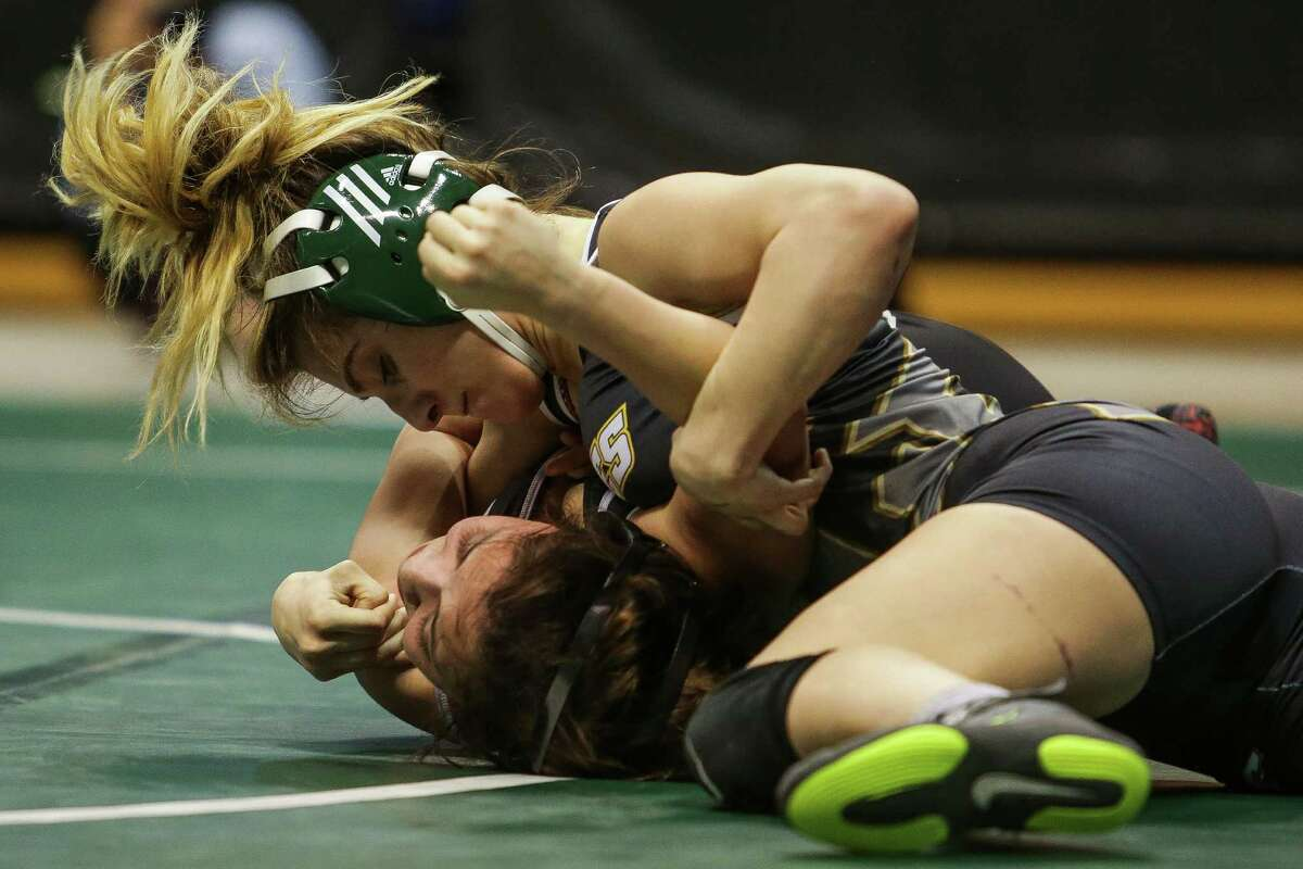 Houston Cy-Falls wrestler Allissa Maldonado pins Tascosa wrestler Mariah Lomas to win the championship match for the 6A, 102 girls at the UIL Wrestling State Championships at the Berry Center Saturday, Feb. 20, 2016.