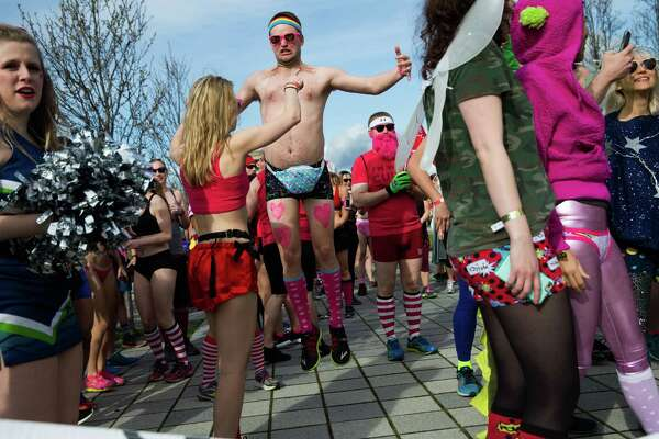 Runners prepare for Cupid's Undie Run at Lake Union Park in Seattle on Saturday. Feb. 20, 2016. The roughly mile-long run around Lake Union Park raises money for The Children's Tumor Foundation.