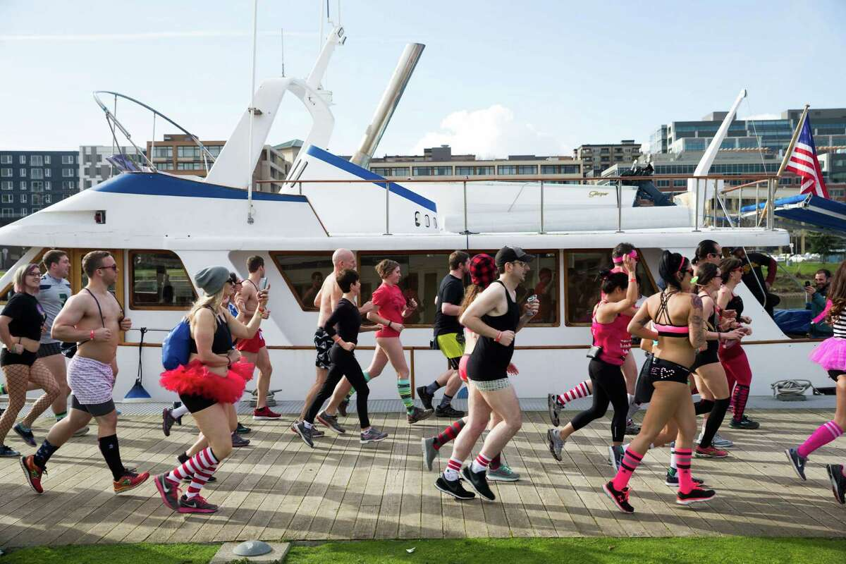 People in their best underwear run in Cupid's Undie Run at Lake Union Park in Seattle on Saturday, Feb. 20, 2016. The roughly mile-long run around Lake Union Park raised money for the Children's Tumor Foundation.