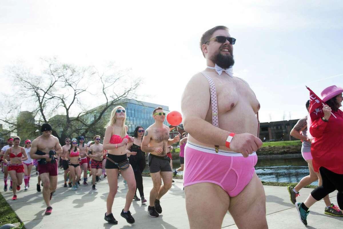 People in their best underwear run in Cupid's Undie Run at Lake Union Park.