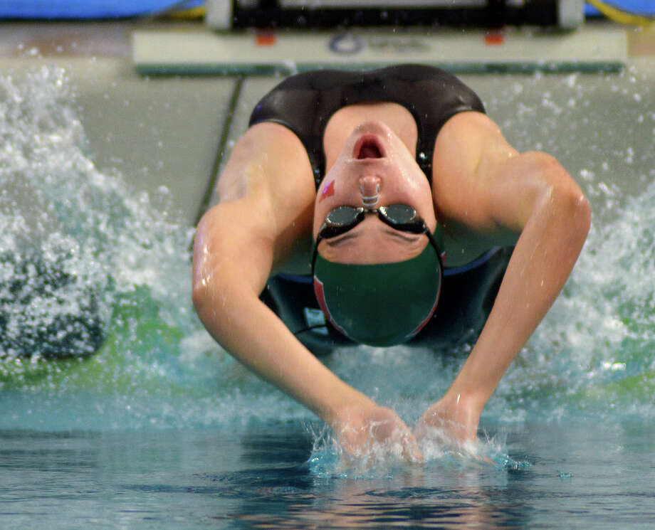 Freshman Lucie Nordman starred for The Woodlands. She won gold in the 50-yard freestyle and the 100-yard backstroke, while she was apart of the silver medal-winning 200-yard medley relay team. Photo: Jerry Baker, For The Houston Chronicle