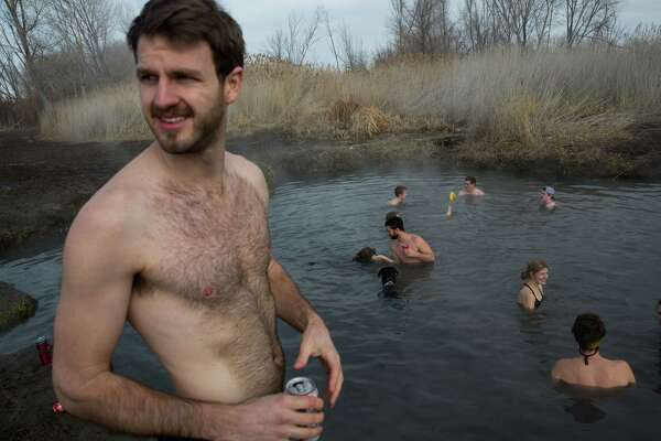 Revelers enjoy a soak and beers at the Saratoga Hot Springs in Saratoga Springs, Utah on Monday, Feb. 15, 2016.
