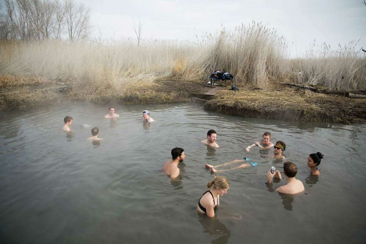 Various groups soak in the muddy, warm waters of the Saratoga Hot Springs in Saratoga Springs, Utah on Monday, Feb. 15, 2016.