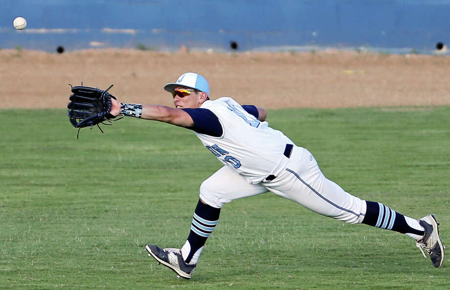 Johnson's Santana Barrera chases down a ball hit by Laredo Alexander's Mario Garcia during the sixth inning of Game 2 in their Region IV-6A final series on June 6, 2015, at SAISD Complex. Photo: Edward A. Ornelas /San Antonio Express-News / © 2015 San Antonio Express-News