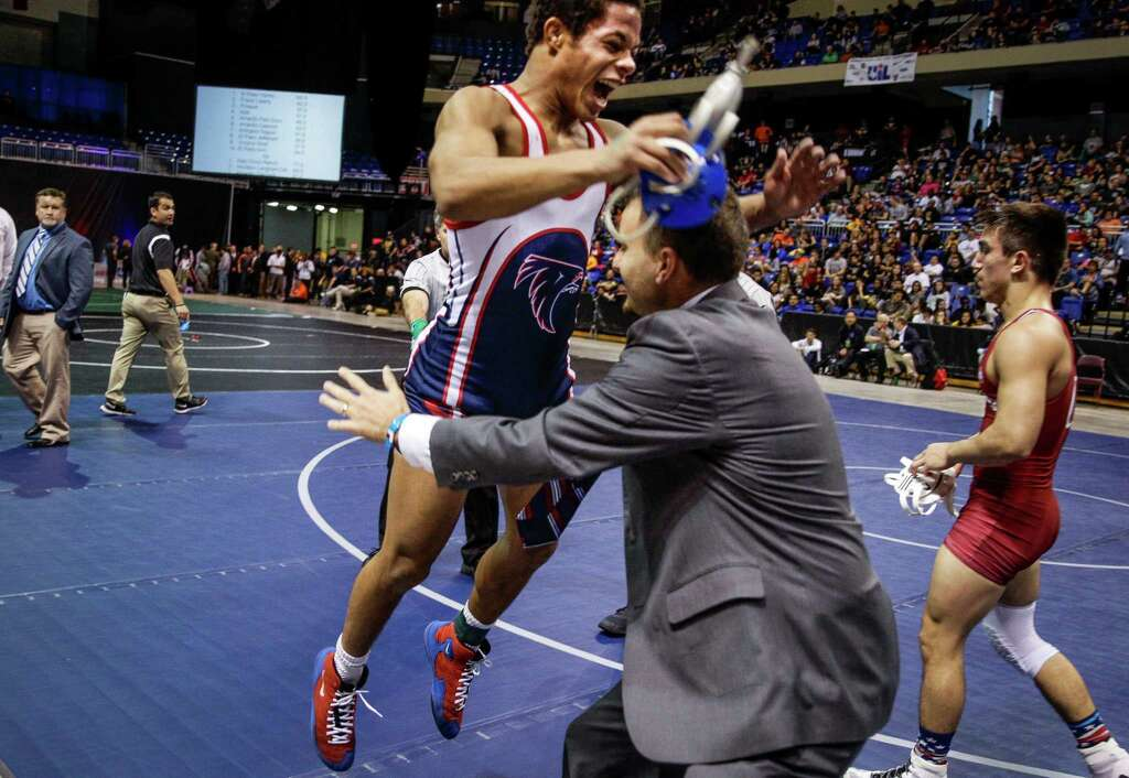 Houston Clear Lake wrestler Camden Fontenot jumps into the arms of his head coach, Shane Zelenski, after beating Keller Central High School wrestler Blaine Martinez 6-5 to win the championship round of the 6A, 132 UIL Wrestling State Championships at the Berry Center Saturday, Feb. 20, 2016. ( Michael Ciaglo / Houston Chronicle ) Photo: Michael Ciaglo, Staff / © 2016  Houston Chronicle