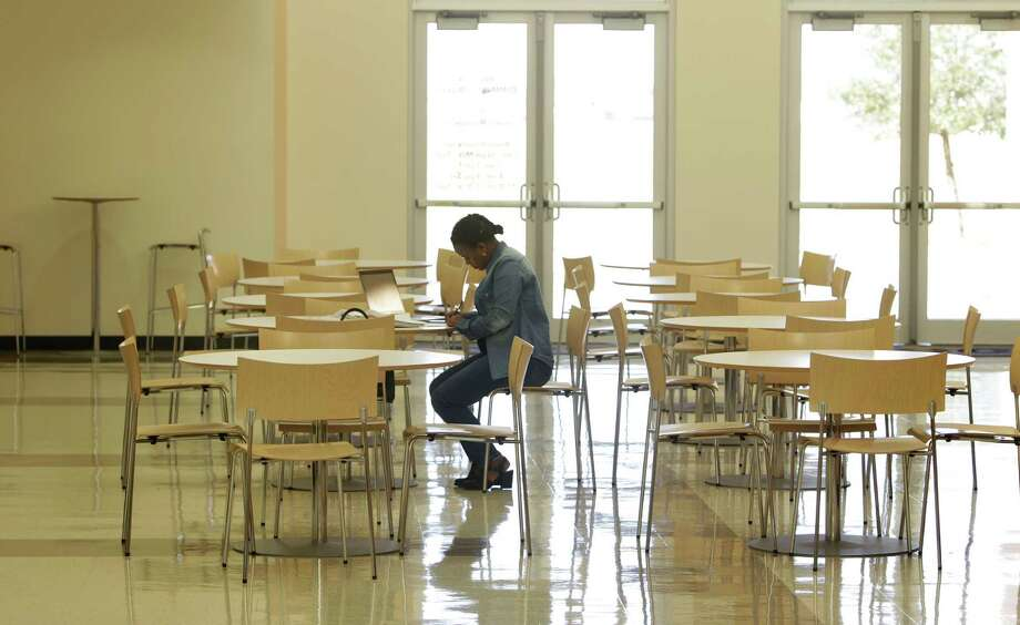 Houston Community College student Selamawit Moges has the entire gather center to herself as she studies Wednesday, Feb. 17, 2016, in Missouri City. Photo: Steve Gonzales / © 2016 Houston Chronicle