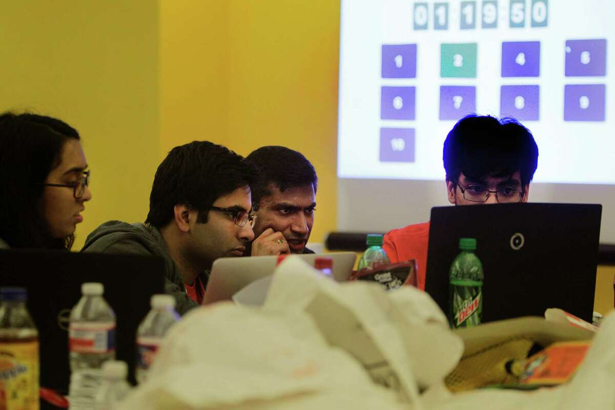University of Texas-Dallas students Amber Hasan, Rupesh Pancholi, and Nikoli Cartagena worked to complete the challend with the help of J.P. Morgan Chase-Dallas' Hagosh Chalasani, second from right. attempt to finish in the Code for Good contest Saturday, Feb. 20, 2016, in Houston. Code for Good, the challenge brings together college students and bank employees who love technology and want to make a difference. These 24-hour events run overnight, with students coding in teams and racing against the clock -and each other - to come up with creative, technological solutions to solve real challenges faced by 2 local nonprofits. The non-profits are community partners of ours - Neighborhood Centers Inc. and the Children's Museum of Houston. ( Steve Gonzales / Houston Chronicle )