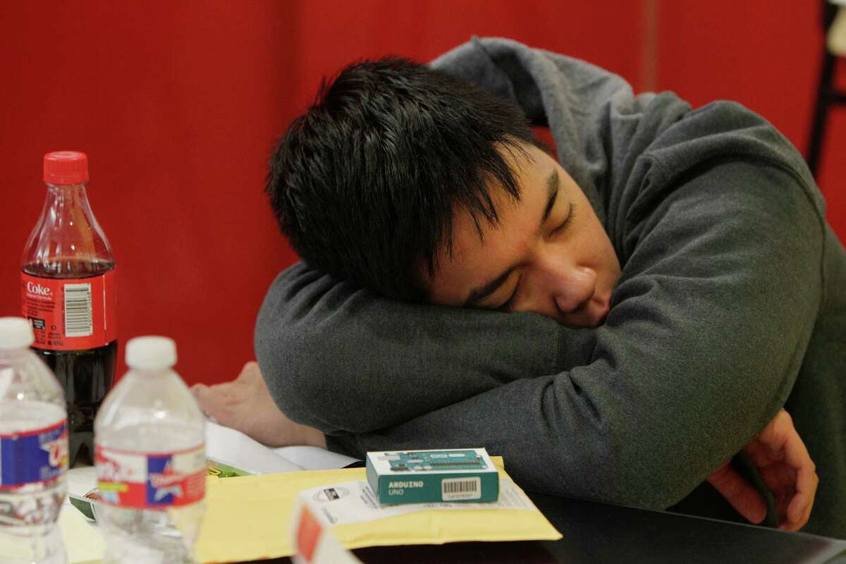 University of Houston student Michael Pham lost the battle to stay awake with an hour and half to go in the Code for Good contest. Saturday, Feb. 20, 2016, in Houston. Code for Good, the challenge brings together college students and bank employees who love technology and want to make a difference. These 24-hour events run overnight, with students coding in teams and racing against the clock -and each other - to come up with creative, technological solutions to solve real challenges faced by 2 local nonprofits. The non-profits are community partners of ours - Neighborhood Centers Inc. and the Children's Museum of Houston. ( Steve Gonzales / Houston Chronicle )