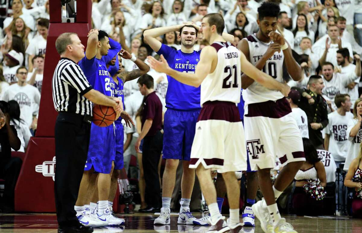 Kentucky's Isaac Humphries, center, reacts after having a technical foul called on him during overtime of an NCAA college basketball game, Saturday, Feb. 20, 2016, in College Station, Texas. Texas A&M won 79-77. (AP Photo/Sam Craft)