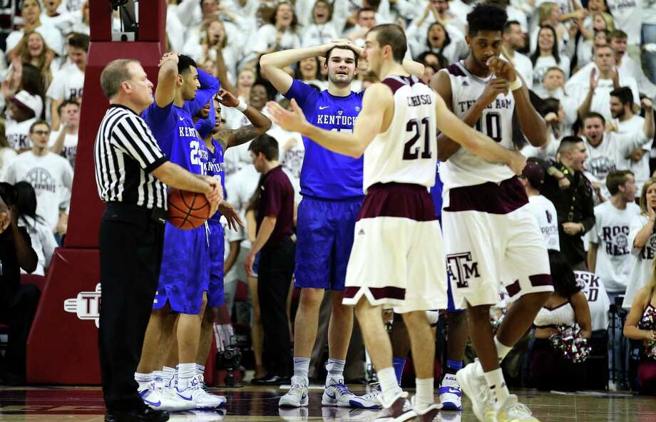 Kentucky's Isaac Humphries, center, reacts after having a technical foul called on him during overtime of an NCAA college basketball game, Saturday, Feb. 20, 2016, in College Station, Texas. Texas A&M won 79-77. (AP Photo/Sam Craft) Photo: Sam Craft, Associated Press / FRE145148 AP