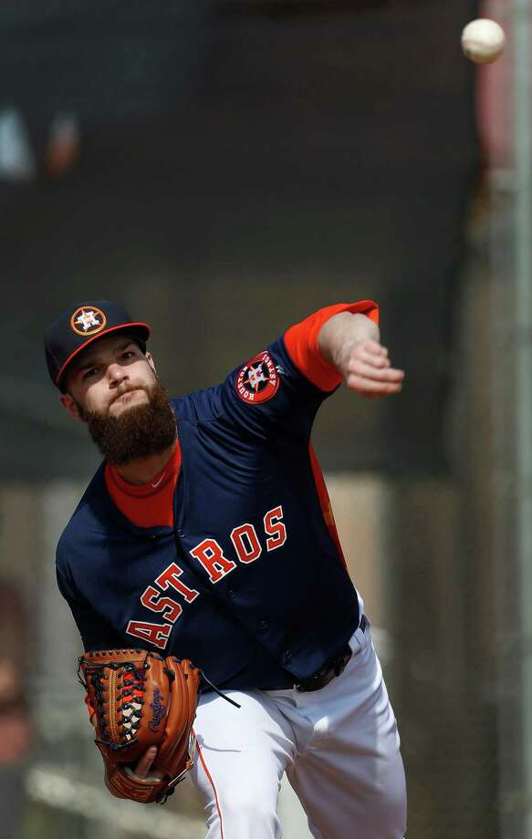 "Astros pitcher Dallas Keuchel won't be shaving his trademark beard during the season, but he says he has thought about shaving it as a way to raise money for charity in the future. ""When the right opportunity comes, it'll come off,"" he said. Photo: Karen Warren, Staff / © 2015  Houston Chronicle"