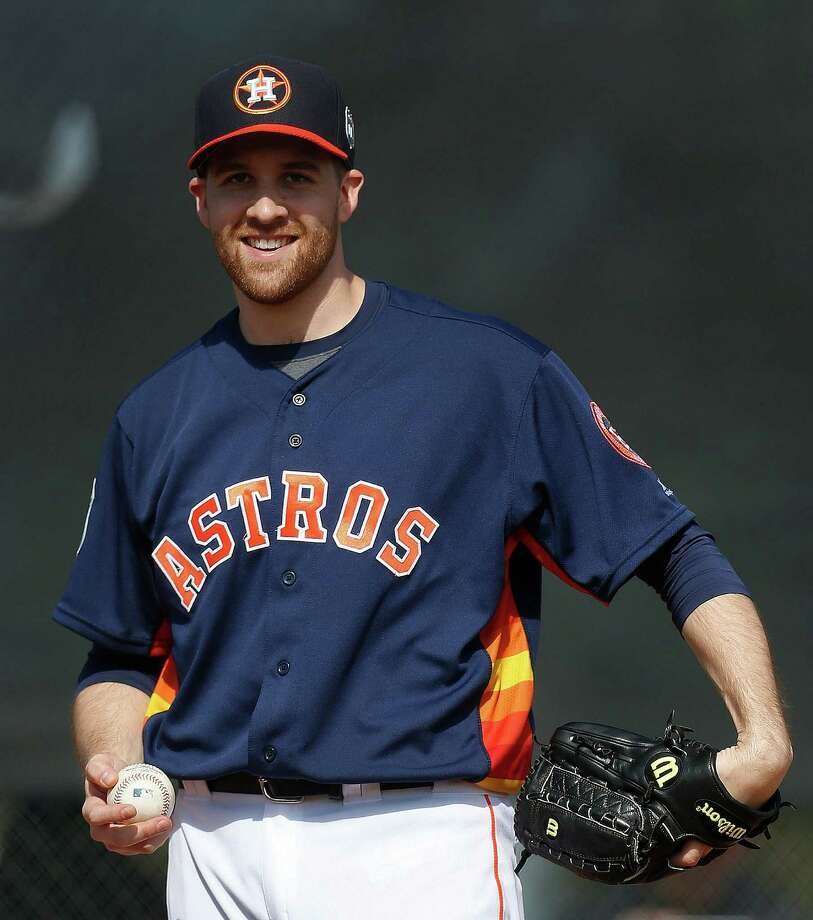 "Astros pitcher Collin McHugh is trying out all of his pitches early in spring training, but he isn't throwing with full effort yet. ""If you can stay around 65-, 75-percent range cleanly up until games, you'll be all right,"" he said. Photo: Karen Warren, Staff / © 2015  Houston Chronicle"