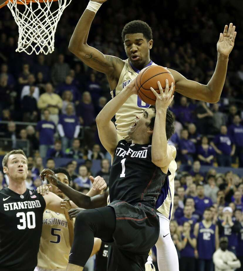 The Huskies' Marquese Chriss (top), who had 11 points, tries to block Stanford's Christian Sanders (1) during the first half. Photo: Ted S. Warren, Associated Press