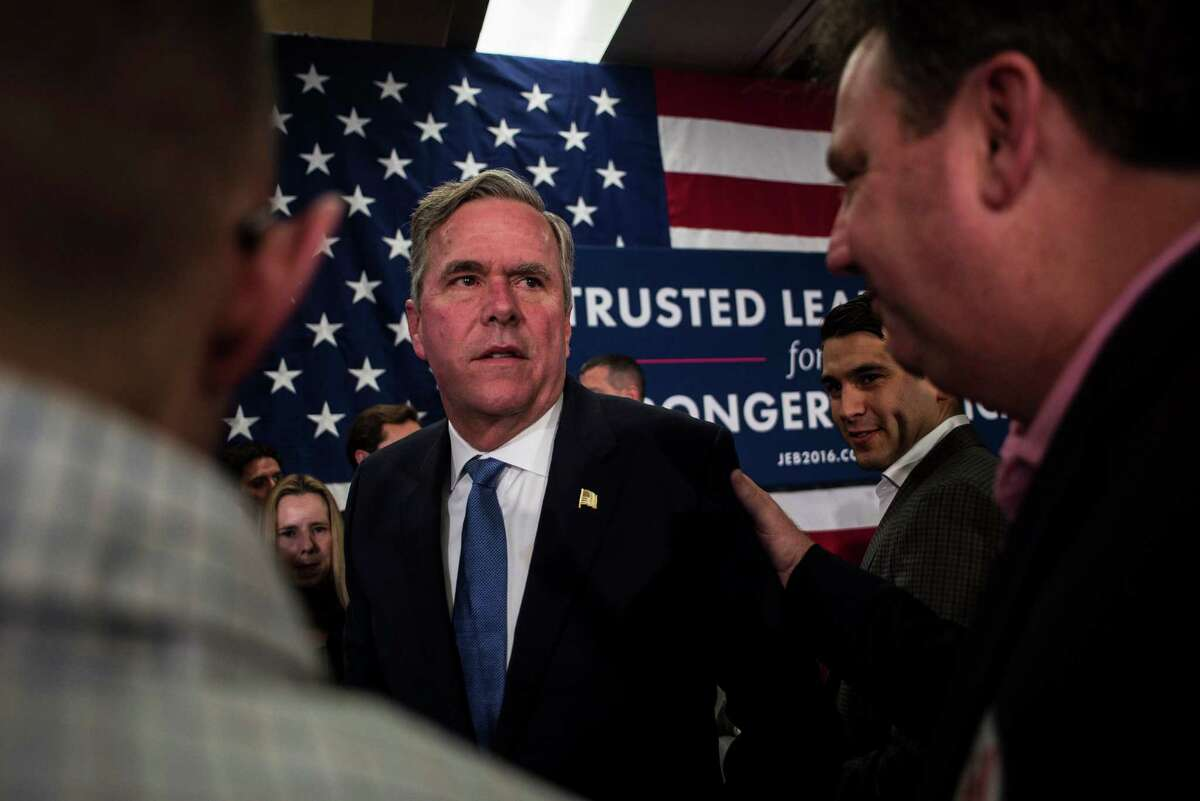 Jeb Bush greets supporters after his concession speech. Donald Trump had been projected as the winner shortly after the polls closed, and an hour later, Bush announced that he was ending his White House quest.