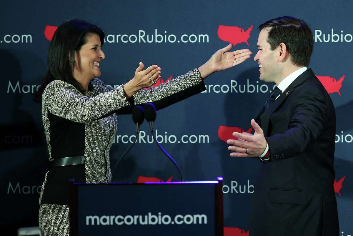 South Carolina Gov. Nikki Haley greets GOP presidential hopeful Marco Rubio before addressing supporters at a primary night event in Columbia.