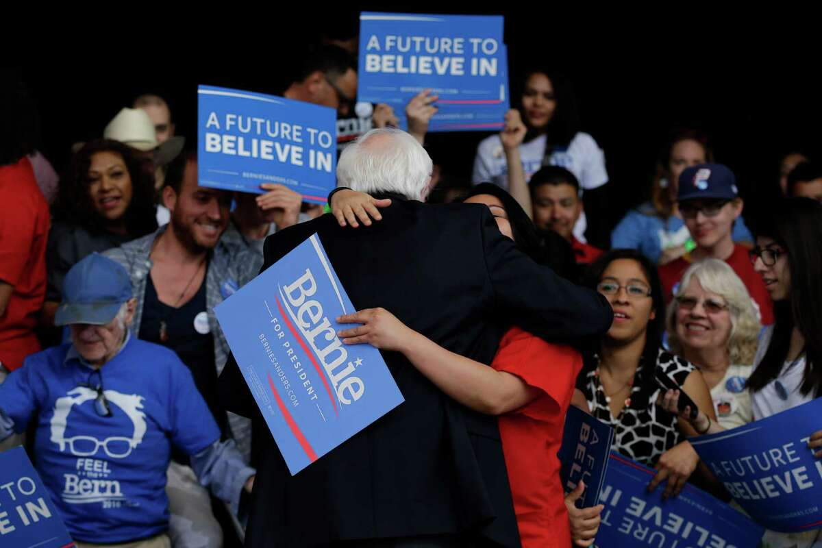 Democratic presidential candidate Sen. Bernie Sanders, I-Vt., gets a hug from a supporter at a Nevada caucus watch party in Henderson, Nev., on Saturday, Feb. 20, 2016.