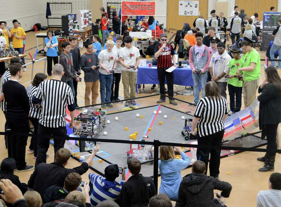 Robots designed by area teens face off in the FIRST Tech Challenge at Greens Farms Academy. Photo: Westport News / Jarret Liotta / Westport News