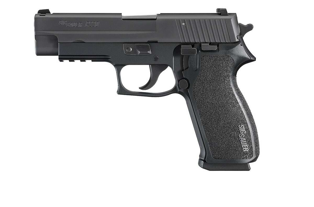 File photo of a Sig Sauer model 220 .45 caliber handgun.A .40 caliber pistol belonging to an Immigration and Customs Enforcement agentwas reported missing in San Francisco Saturday.