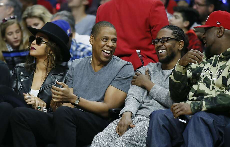 "Beyonce, Jay Z, Kendrick Lamar and Anthony ""Top Dawg"" Tiffith attend the NBA basketball game between the Los Angeles Clippers and Golden State Warriors Saturday, Feb. 20, 2016, in Los Angeles. (AP Photo/Danny Moloshok) Photo: Danny Moloshok, Associated Press"