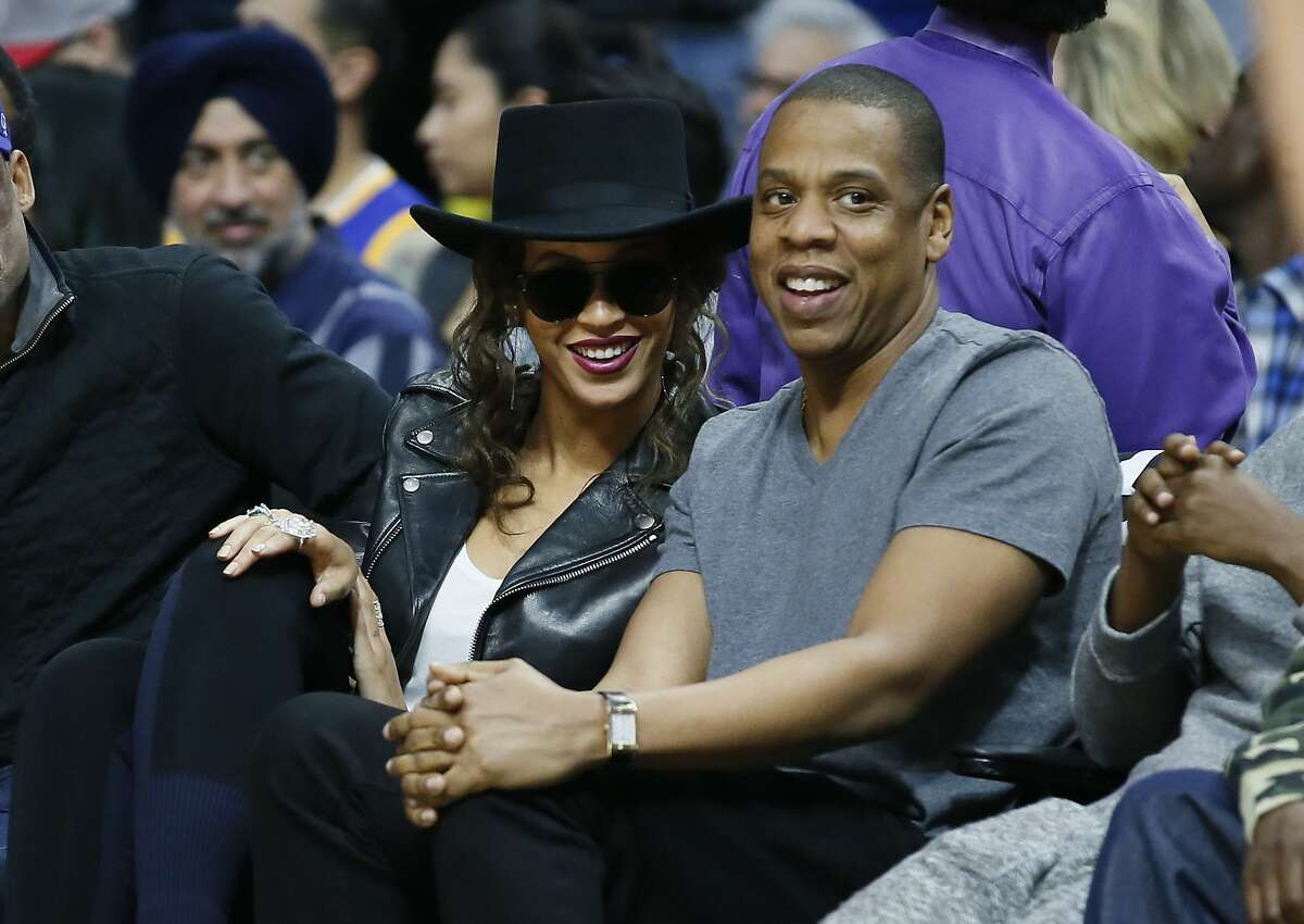 Beyonce and Jay Z attend the NBA basketball game between the Los Angeles Clippers and Golden State Warriors Saturday, Feb. 20, 2016, in Los Angeles. (AP Photo/Danny Moloshok)