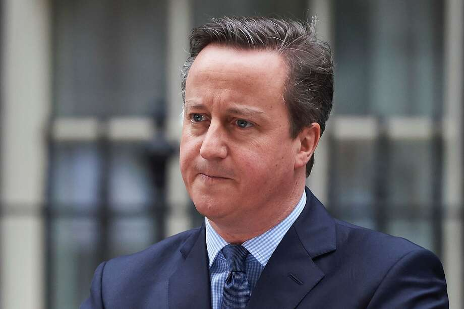 """British Prime Minister David Cameron makes a statement to the media outside 10 Downing Street in London on February 20 , 2016 regarding the EU negotiations and to announce the date of the in-out EU referendum after chairing a meeting of the cabinet.  Prime Minister David Cameron takes a deal giving Britain """"special status"""" in the EU back to London on February 20 hoping it will be enough to keep his country in the bloc as campaigning begins for a crucial in-out referendum. The prime minister announced that the referendum would be held on June 23. / AFP / NIKLAS HALLE'NNIKLAS HALLE'N/AFP/Getty Images Photo: Niklas Halle'n, AFP / Getty Images"""