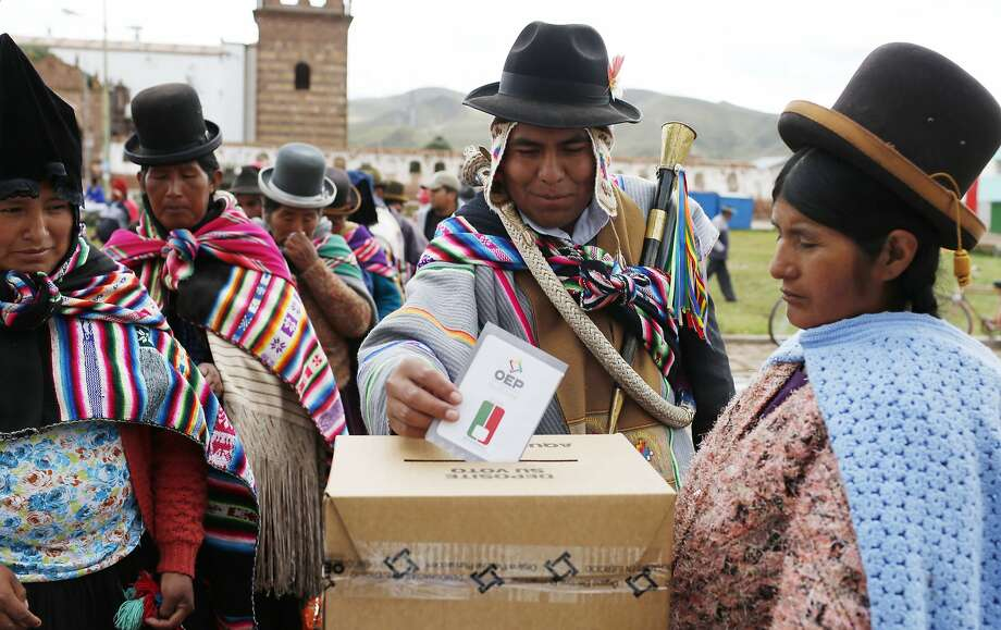 An Aymara Indian votes in the constitutional referendum in Jesus de Machaca, Bolivia. Voters are deciding whether longtime President Evo Morales can run for re-election again in 2019. Photo: Juan Karita, Associated Press