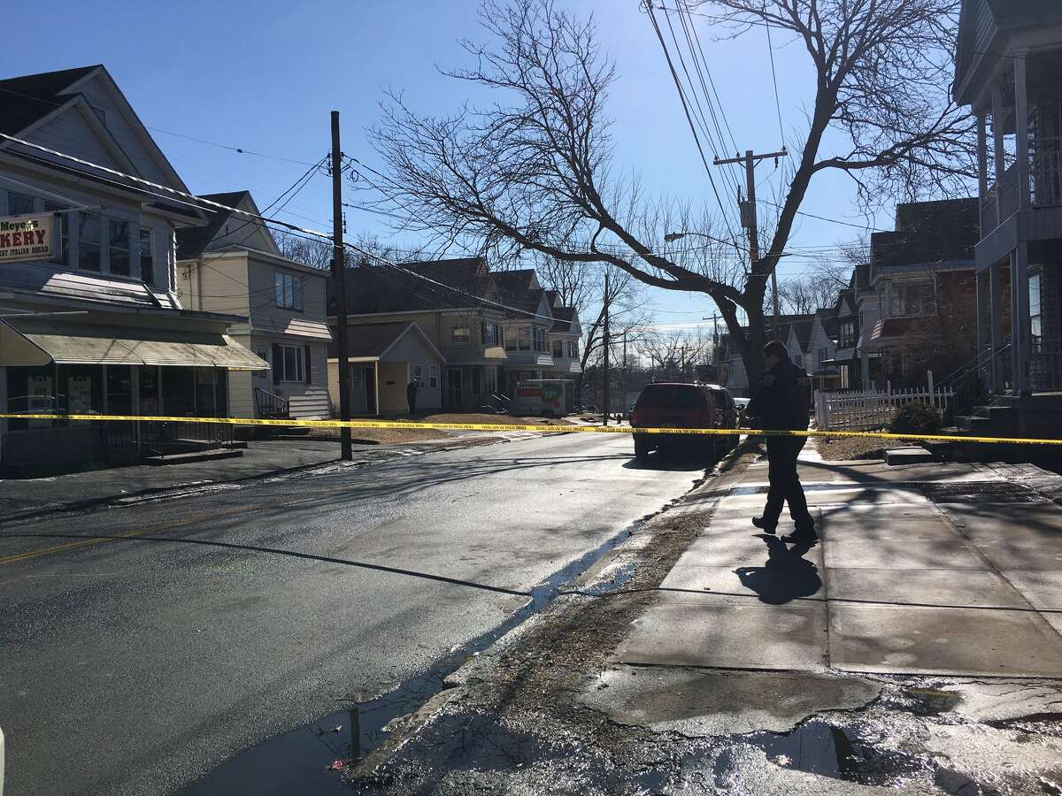 Police tape stretches across the road near a shooting in Schenectady, where a man was allegedly shot in the head while in his home on the 1300 block of Crane Street on Saturday, February 20, 2016. (Lindsay Ellis/Times Union)