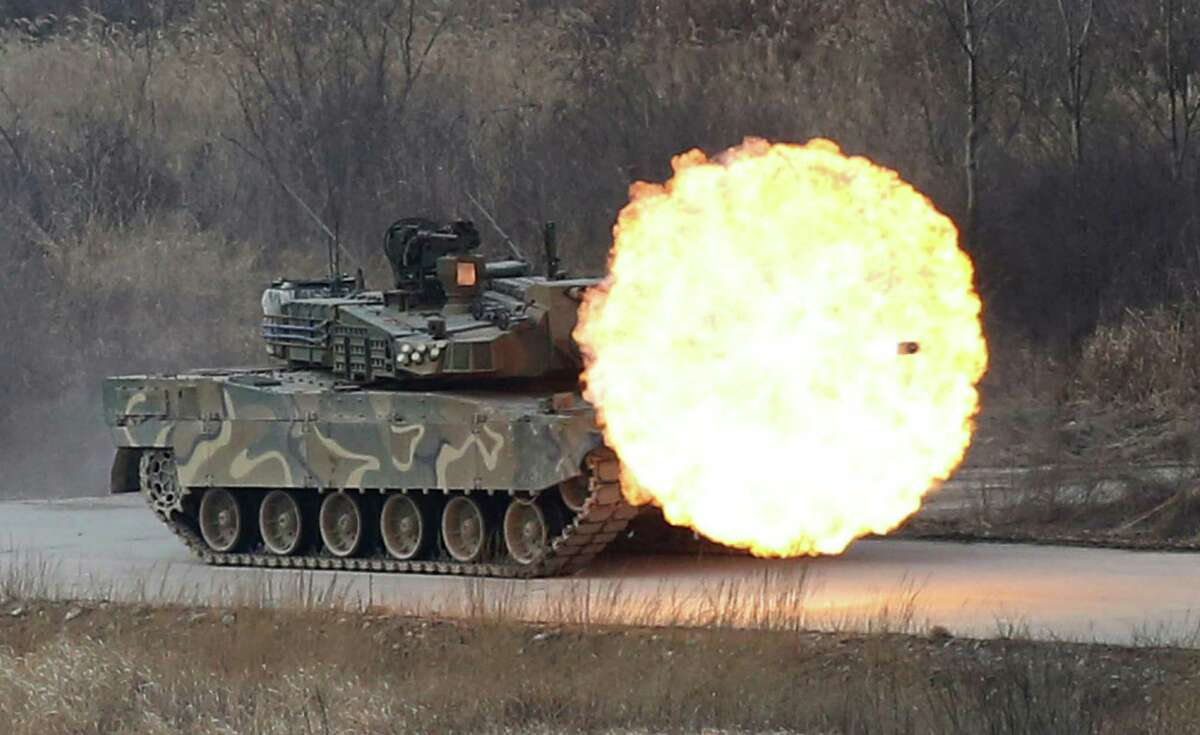 A South Korean army K-2 tank fires during a live firing drill at a fire training field in Yangpyeong, South Korea, Thursday, Feb. 18, 2016. North Korean leader Kim Jong Un recently ordered preparations for launching