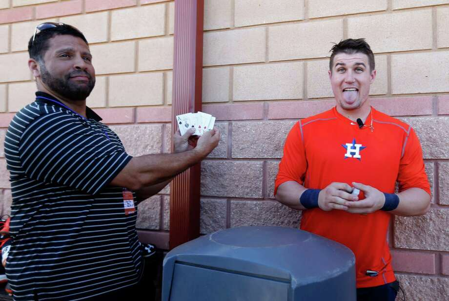 Houston Astros catcher Tyler Heineman reacts after performing a card trick for the media with the help of Gene Dias, Vice President of Media Relations, after workouts during spring training in Kissimmee, Florida, Sunday, Feb. 21, 2016. Photo: Karen Warren, Houston Chronicle / © 2015  Houston Chronicle