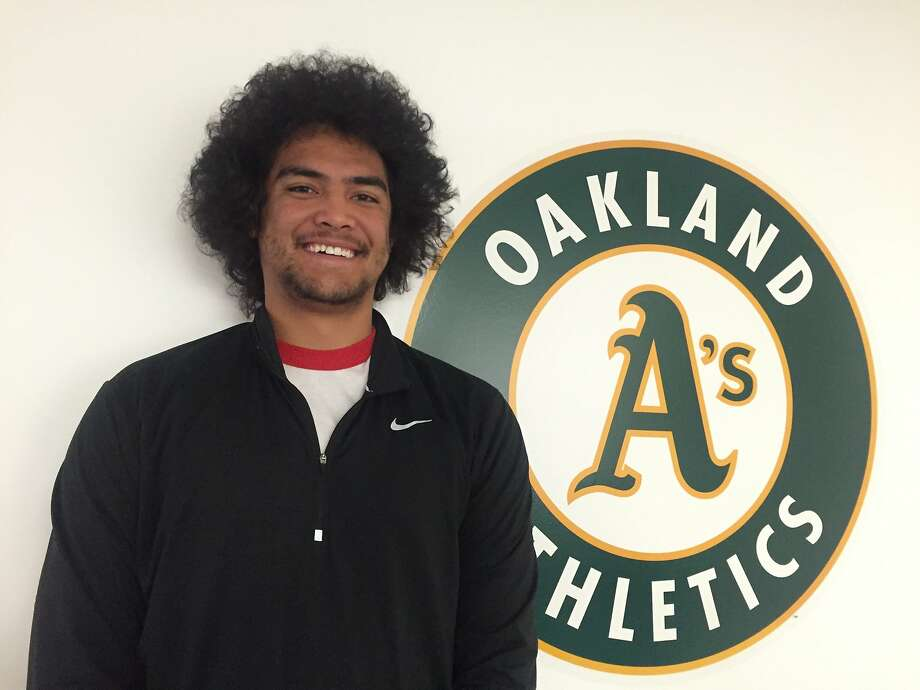 "Sean Manaea, the A's top prospect, is of Samoan descent and calls his hairstyle a ""Samo-fro."" Photo: Susan Slusser, San Francisco Chronicle"