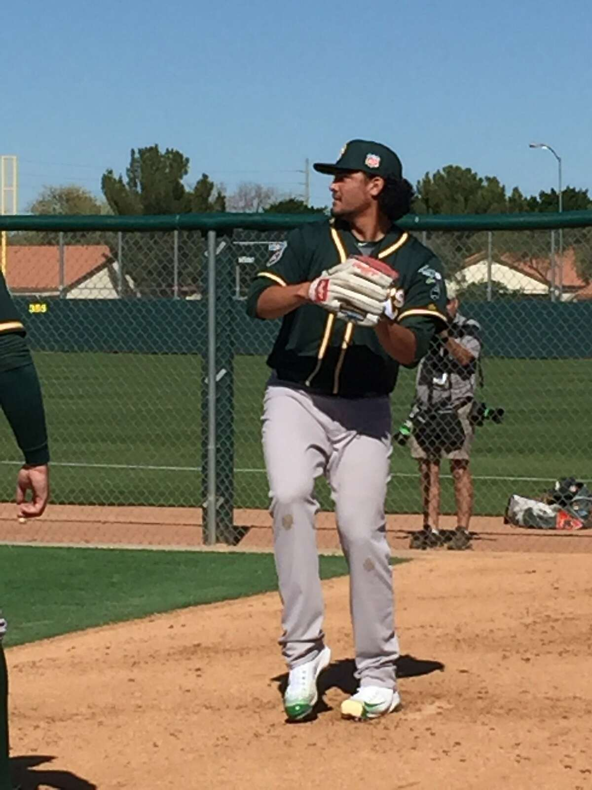 Sean Manaea, the A's top pitching prospect, throws a bullpen session on the first day of the team's camp in Mesa, Ariz.